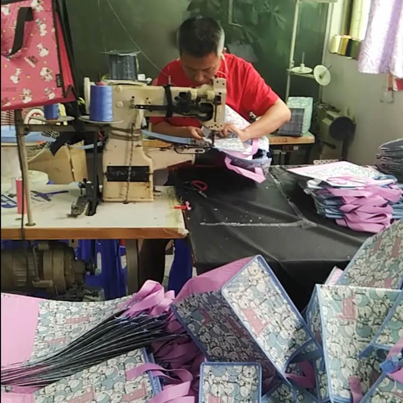 Senior sewing worker of Linway backpack manufacturer